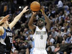 Ty Lawson (3) hit 10 three-pointers and poured in a career-high 37 points as the Nuggets beat the Timberwolves for the 16th time in 17 games.