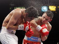Marcos Maidana, right, outpointed Erik Morales to claim the vacant WBA interim super-lightweight title.