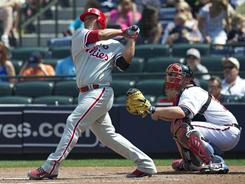 Phillies catcher Carlos Ruiz cracks a grand slam at Turner Field to help subdue the Braves 10-2.