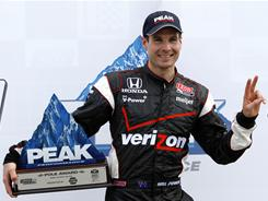 Will Power celebrates after earning the pole position at the Honda Grand Prix of Alabama for the second consecutive year.