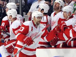 Detroit Red Wings center Pavel Datsyuk is congratulated by his teammates for scoring a second-period goal.