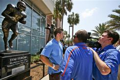 Former Florida quarterback Tim Tebow stands in front of his statue outside Ben Hill Griffin Stadium in Gainesville, Fla.