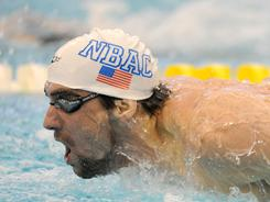 Michael Phelps competes in the men's 200 meter butterfly finals at the Michigan Grand Prix swimming meet in Ann Arbor, Mich. on April 9.