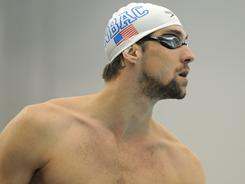 Michael Phelps looks out over the pool before the start of his heat in the 200-meter individual medley during the finals of the Eric Namesnik Grand Prix swimming meet at Canham Natatorium in Ann Arbor, Mich., on April 10.