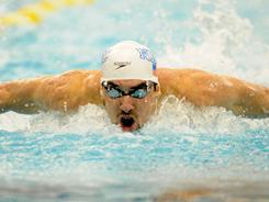 Michael Phelps competes in the 100-meter butterfly final during the Michigan Grand Prix swimming meet in Ann Arbor on Friday.