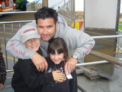 Bryan Stow holds his 12-year-old son and 8-year-old daughter.