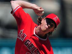 Jered Weaver struck out 15, walked four and allowed four hits Sunday.