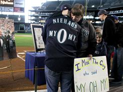Noel Renggli, left, and Colleen Doser were among 4,000 fans who gathered at a Safeco Field memorial ceremony in November, three days after the death of Dave Niehaus the team's longtime play-by-play man.