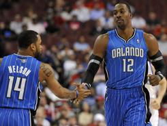 Dwight Howard, right, had 19 points and 13 rebounds as the Magic kept the 76ers at bay in a playoff warm-up for both teams.