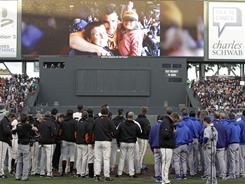 Giants and Dodgers stand for a moment of silence for paramedic Bryan Stow, pictured above, who was beaten at Dodger Stadium earlier this month, before their baseball game in San Francisco.