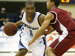 Brandon Johnson, left, finished his playing career at San Diego in 2010 as the school's leader in scoring and assists.