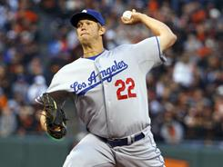 Clayton Kershaw shut down San Francisco for the second time this season and extended his scoreless innings streak against the rival Giants to 23 2/3 innings.