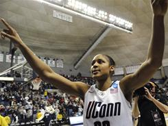 Maya Moore, who helped UConn win two national championships, was selected by the Minnesota Lynx with the first pick in the WNBA Draft on Monday.
