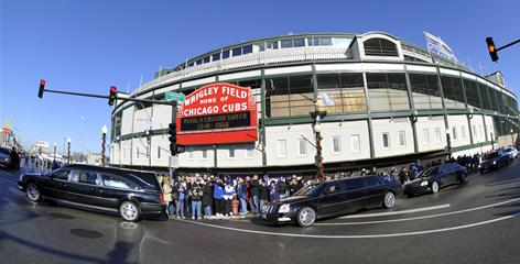 The funeral procession for former Chicago Cubs great and longtime broadcaster Ron Santo passes Wrigley Field on Dec. 3.