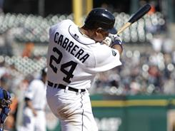 Tigers slugger Miguel Cabrera hits the game winning RBI-single against the Rangers in the ninth inning.