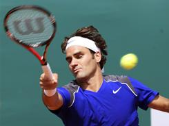 Roger Federer of Switzerland lines up a forehand during his victory Tuesday against Philipp Kohlschreiber of Germany at the Monte Carlo Masters.