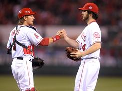 Catcher Jeff Mathis, left, shakes hands with starter Dan Haren after he threw a one-hit shutout against the Indians in Anaheim. The loss snapped the Indians' winning streak at eight games.