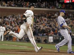 Aaron Rowand, left, scored what proved to be the winning run on a wild pitch in the seventh inning as the Giants defeated the Dodgers 5-4 Tuesday in San Francisco.