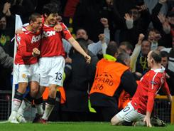 Manchester United's Park Ji-sung, second from left, celebrates his game-winning goal against Chelsea with his Red Devil teammates.