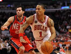 Bulls point guard Derrick Rose had 15 points in Wedneday night's game against the New Jersey Nets.