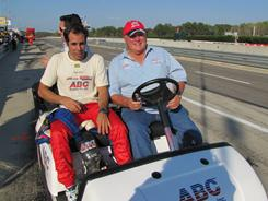 Vitor Meira, left, with owner A.J. Foyt driving golf cart, rallied to finish 12th in Sunday's IndyCar race.