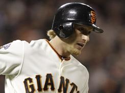 Homers by the Giants' Mike Fontenot, above, and Pablo Sandoval in the sixth inning provided the winning marging against the rival Dodgers.