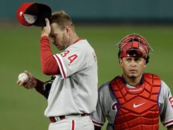 Phillies pitcher Roy Halladay, left, with catcher Carlos Ruiz, improved to 2-0 with a 3-2 win vs. the Nationals on Wednesday.