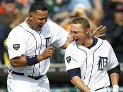 Tigers' Miguel Cabrera congratulates Brandon Inge after he hits a walk off home run against the Rangers at Comerica Park.