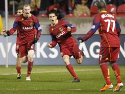 Fabian Espindola, center, Andy Williams, right, and Nat Borchers of Real Salt Lake celebrate Espindola's game-winning goal in the last minutes against the Colorado Rapids on Wednesday night.