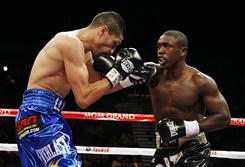 Andre Berto, right, lands a punch against Freddy Hernandez during their WBC welterweight championship Nov. 27, 2010, in Las Vegas.