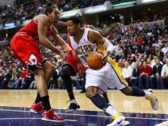 Forward Danny Granger, right, averaging 20.5 points a game, will lead the Pacers against center Joakim Noah (10.4 rebounds a game) and the top-seeded Bulls.