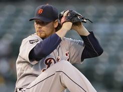 Phil Coke worked seven shutout innings and the Tigers' bullpen held strong as Detroit held off the A's 3-0.