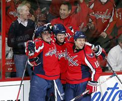 Washington Capitals center Jason Arnott, center, celebrates with forwards Alex Ovechkin, left, and Marco Sturm after scoring a goal against the New York Rangers in Game 2 of their first-round playoff series in Washington. The Capitals won 2-0.