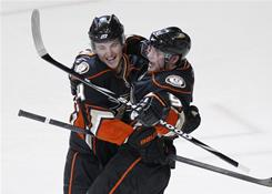 Ducks right wing Bobby Ryan, right, celebrates his empty-net goal with Cam Fowler during their first-round game against the Nashville Predators in Anaheim, Calif. The Ducks won 5-3.