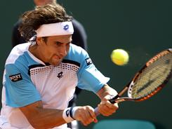 David Ferrer of Spain powers a backhand during his victory Friday against Viktor Troicki of Serbia in the quarterfinals of the Monte Carlo Masters in Monaco.