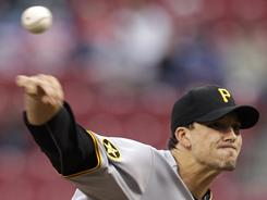 Pirates starter Charlie Morton slowed the Reds' attack, inducing 15 ground-ball outs in his complete-game effort Friday.