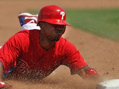 The Phillies' Jimmy Rollins, stealing third, has an 83.1% success rate on the base paths.
