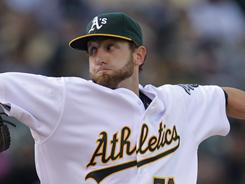 A's starter' Dallas Braden worked five innings of three-hit ball, getting his first win of the season as Oakland beat the Detroit Tigers on Saturday 6-2.
