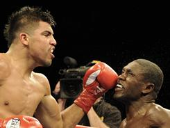 Victor Ortiz, left, trades punches with Andre Berto during the sixth round of their WBC welterweight championship fight on Saturday. Ortiz won by unanimous decision.