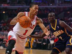 The Bulls' Derrick Rose, left, driving against Pacers point guard Darren Collison, scored a game-high 39 points to help Chicago rally for a 104-99 win Saturday.
