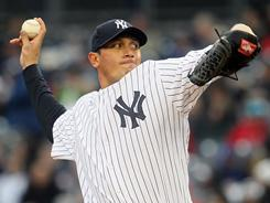Yankees starter Freddy Garcia allowed just two hits over six shutout innings to earn his first win of the season.