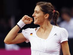 Andrea Petkovic celebrates after beating Christina Mchale of the USA 6-3, 6-4 to give Germany a 1-0 lead in the Fed Cup World Group playoff on Saturday in Stuttgart.