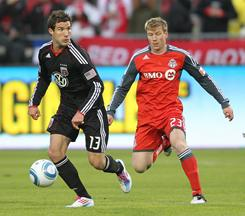 Toronto FC's Jacob Peterson, right, chases after D.C. United's Chris Pontius during their game in Toronto. D.C. United won 3-0.