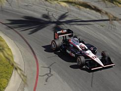 Australia's Will Power, speeding through qualifying for the Grand Prix of Long Beach on Saturday, earned his third consecutive pole.