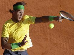 Rafael Nadal of Spain lines up a forehand during his victory against Andy Murray of Britain on Saturday in the semifinals of the of the Monte Carlo Masters in Monaco.