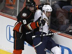 The Ducks' Bobby Ryan, left, checking the Predators' Ryan Suter into the boards during Game 2, was suspended for the next two games.