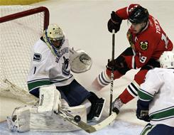 Canucks goalie Roberto Luongo blocks a shot by the Blackhawks' Jonathan Toews during Game 3 of Vancouver's first-round playoff series with Chicago.
