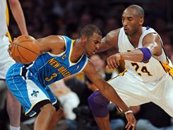 Hornets point guard Chris Paul, left, being defended by Lakers guard Kobe Bryant, scored 17 of his 33 points in the fourth quarter of New Orleans' 109-100 win over Los Angeles.