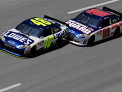 Dale Earnhardt Jr. (88) pushes Jimmie Johnson (48) to his first win of the season Sunday at Talladega.
