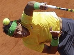 Rafael Nadal of Spain fires a serve during his match Sunday against countryman David Ferrer of Spain in the final of the Monte Carlo Masters in Monaco.